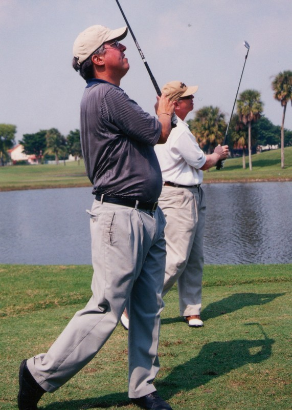 In 2001, I played 136 holes in one day at Doral with Jim McLean, who runs a golf school there. We started on the Blue Monster and averaged forty-five minutes per eighteen, and to save time we often teed off simultaneously, as in the photo above.
