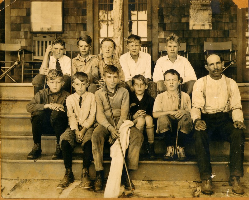 I don't mind seeing ties on ten-year-old caddies in 1925, as in this photo, which was taken at my golf club. The pro when I joined, in 1991, was the son of tiny kid who is fourth from the left in the front row.