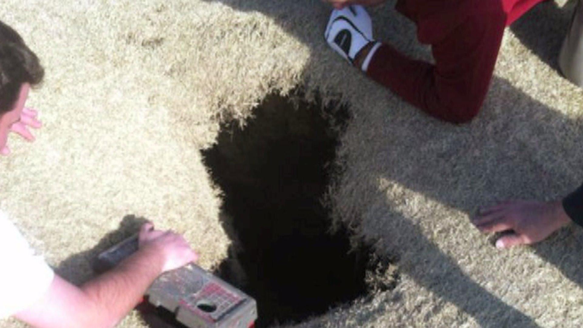 golfer in sinkhole