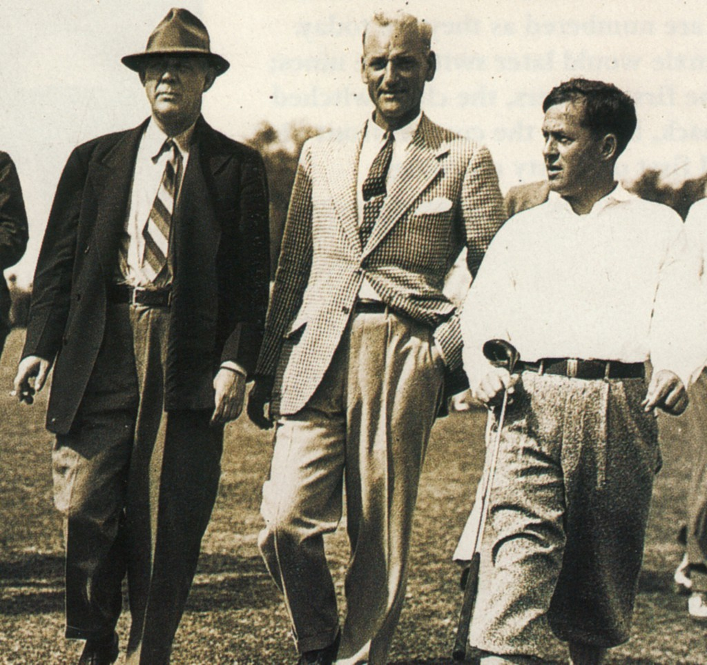 That's Grantland Rice on the left and Bobby Jones on the right, during an early Masters. I don't know who is in the middle.
